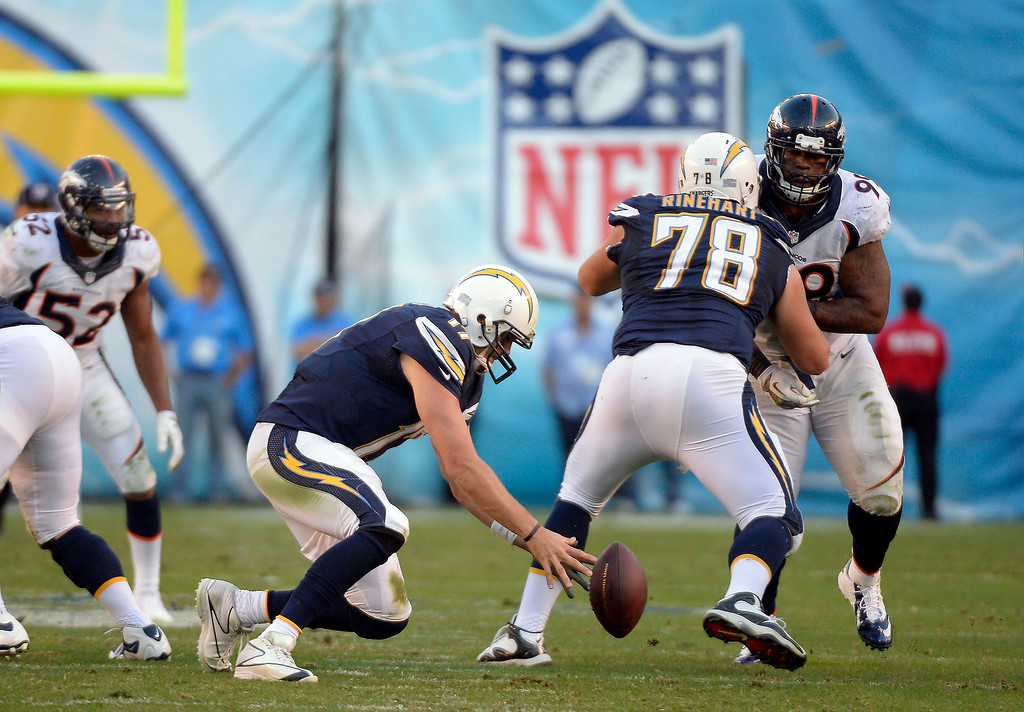 . San Diego Chargers quarterback Philip Rivers (17) scrambles after a loose ball during the fourth quarter at Qualcomm Stadium. (Photo by John Leyba/The Denver Post)