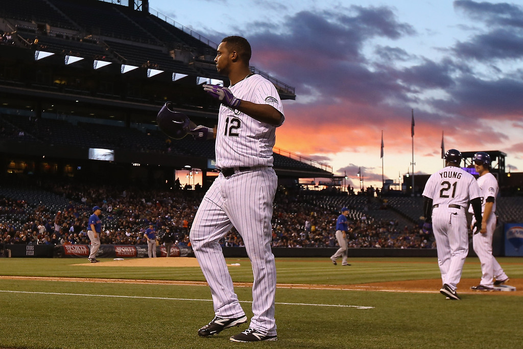 . Juan Nicasio #12 of the Colorado Rockies reacts after hitting a sacrifice fly off of starting pitcher Bartolo Colon #40 of the New York Mets to score Wilin Rosario #20 of the Colorado Rockies and take a 4-0 lead in the fourth inning at Coors Field on May 1, 2014 in Denver, Colorado.  (Photo by Doug Pensinger/Getty Images)