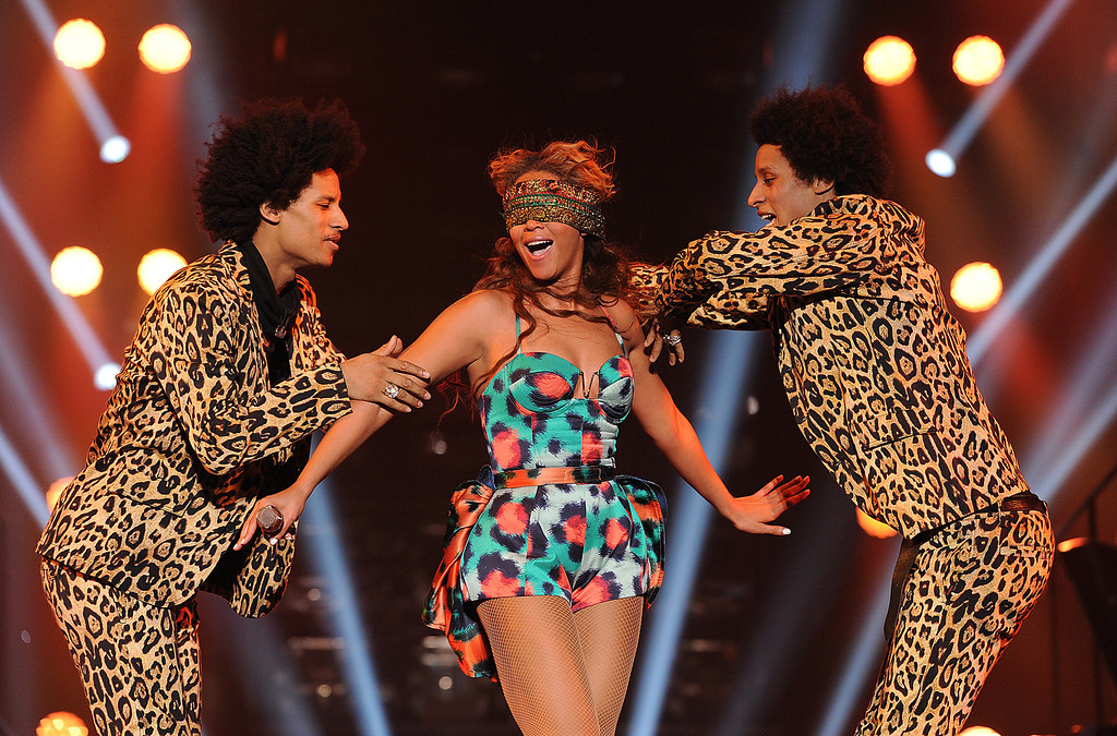 """. Singer Beyonce performs the song \""""Grown Woman\"""" with dancers \""""Les Twins\"""" on her \""""Mrs. Carter Show World Tour 2013\"""", on Wednesday, April 24, 2013 at the Palais Omni Sport Bercy in Paris, France. Beyonce is wearing a custom printed romper with bustle by designer Kenzo. (Photo by Frank Micelotta/Invision for Parkwood Entertainment/AP Images."""