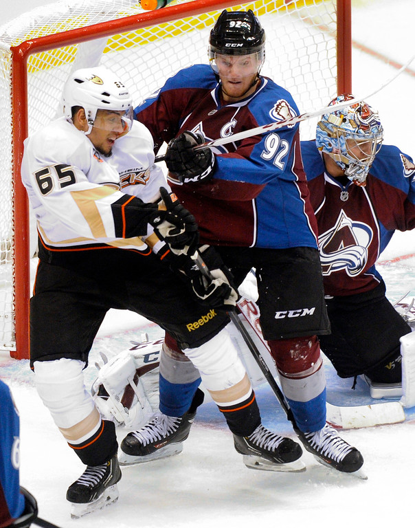 . Colorado wing Gabriel Landeskog (92) tried to clear Anaheim forward Emerson Etem (65) from the crease in the second period. Photo By Karl Gehring/The Denver Post