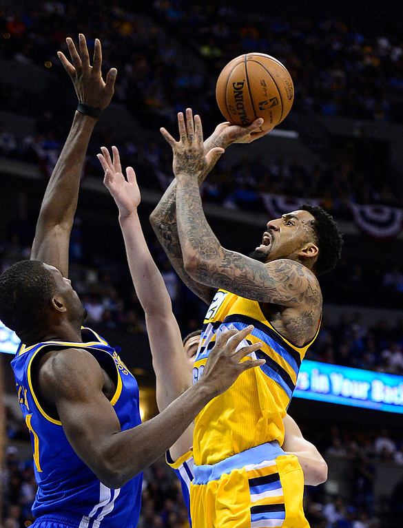 . DENVER, CO. - APRIL 23: Denver Nuggets shooting guard Wilson Chandler (21) puts up a shot against Golden State Warriors center Festus Ezeli (31) in the third quarter. The Denver Nuggets took on the Golden State Warriors in Game 2 of the Western Conference First Round Series at the Pepsi Center in Denver, Colo. on April 23, 2013. (Photo by AAron Ontiveroz/The Denver Post)