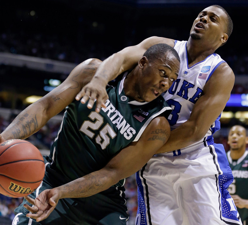 . Michigan State forward Derrick Nix (25) and Duke guard Tyler Thornton (3) fight for a rebound during the first half of a regional semifinal in the NCAA college basketball tournament, Friday, March 29, 2013, in Indianapolis. (AP Photo/Michael Conroy)