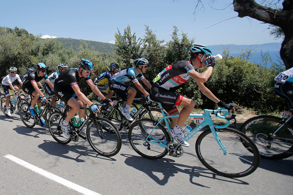 . Andy Schleck of Luxembourg, drinking at right, Niki Terpstra of The Netherlands, second right, Ian Stannard of Britain, fourth form right, and Edvald Boasson Hagen of Norway, far left in black, ride in the pack during the third stage of the Tour de France cycling race over 145.5 kilometers (91 miles) with start in Ajaccio and finish in Calvi, Corsica island, France, Monday July 1, 2013. (AP Photo/Christophe Ena)