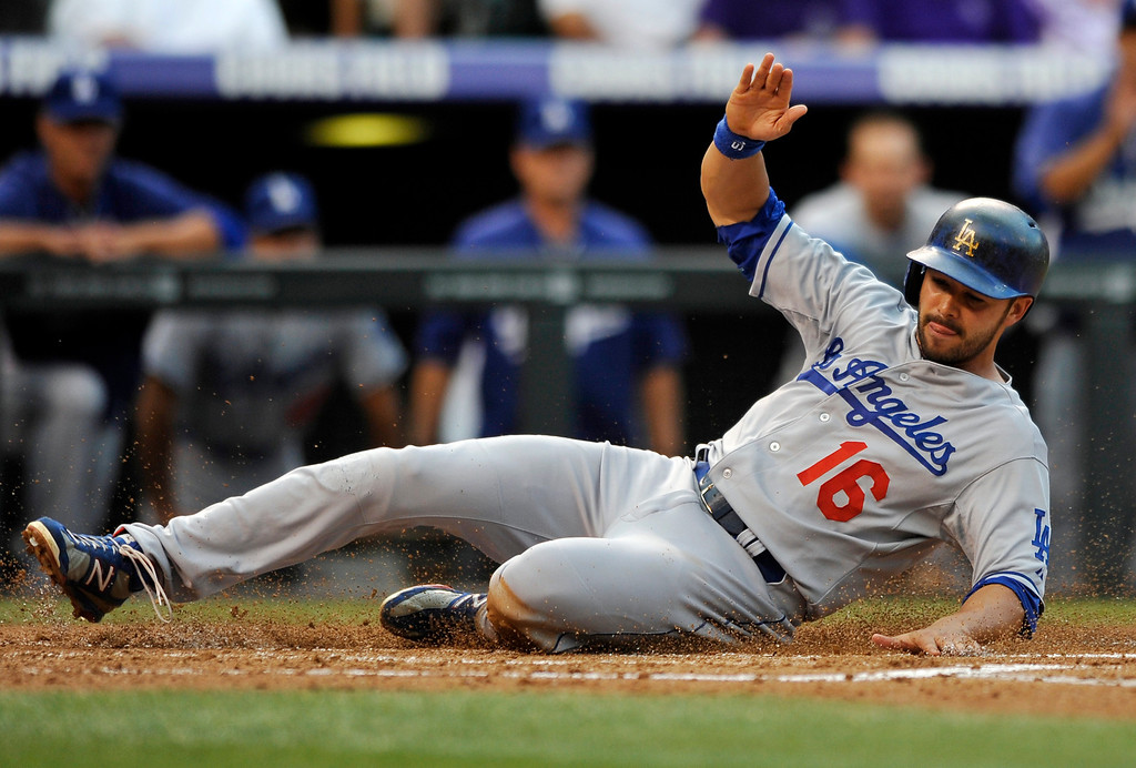 . Los Angeles Dodgers\' Andre Ethier slides safely into home on a Tim Federowicz sacrifice fly during the second inning of a baseball game against the Colorado Rockies, Tuesday, Sept. 3, 2013, in Denver. (AP Photo/Jack Dempsey)