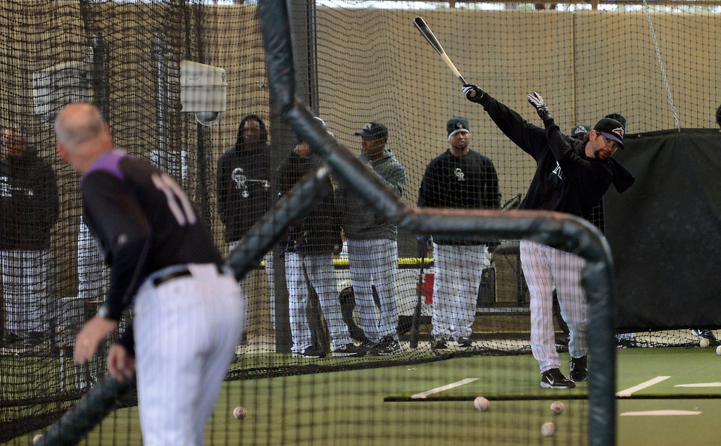 . SCOTTSDALE, AZ. - FEBRUARY 20: Todd Helton (17) of the Colorado Rockies takes in some batting practice during workouts in the cages due to rain at Spring Training February 20, 2013 in Scottsdale. (Photo By John Leyba/The Denver Post)