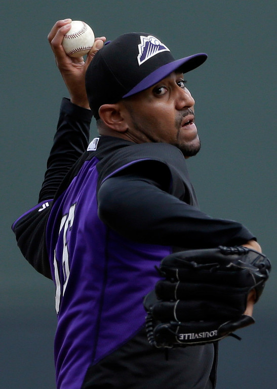. Colorado Rockies starting pitcher Franklin Morales throws against the Arizona Diamondbacks during the first inning in a spring training baseball game on Friday, Feb. 28, 2014, in Scottsdale, Ariz. (AP Photo/Gregory Bull)