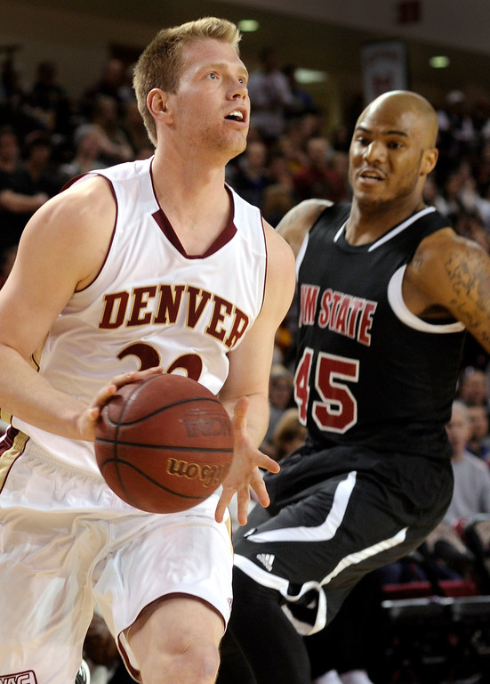 . DENVER, CO. - MARCH 2: Denver guard Chase Hallam (32) got past Aggies defender Tyrone Watson (45) for an open look in the first half. The University of Denver men\'s basketball team defeated New Mexico State 66-60 Saturday evening, March 2, 2013 at Magness Arena. (Photo By Karl Gehring/The Denver Post)