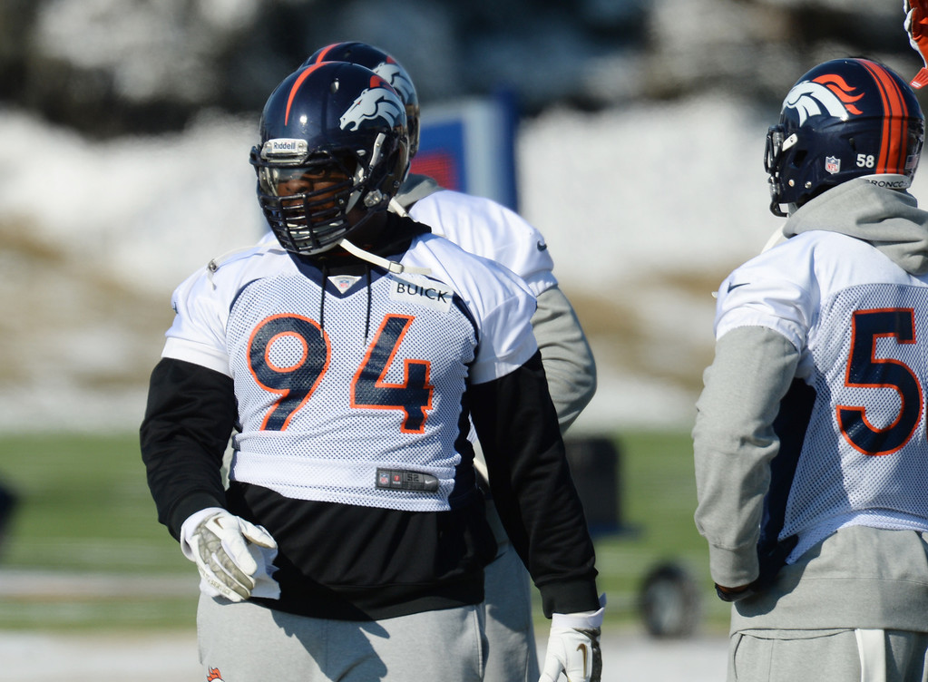 . Terrance Knighton (94) is warming up for the practice at Denver Broncos Headquarters at Dove Valley in Englewood, Colorado on Friday,  December 6, 2013. (Photo by Hyoung Chang/The Denver Post)