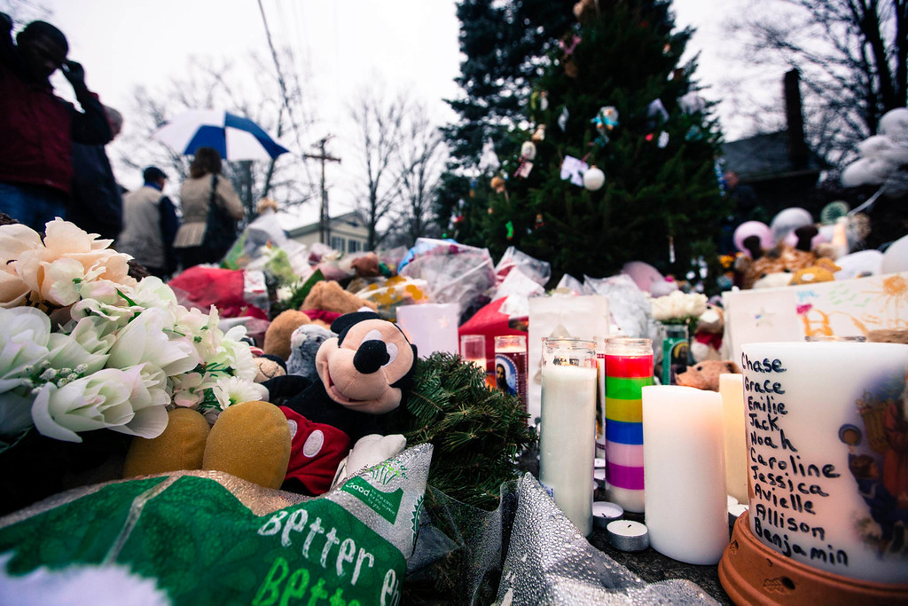 . A candle with the names of victims written on it left among stuffed animals and candles in a memorial to the victims of the recent school shooting in Sandy Hook village in Newtown, Connecticut, December 16, 2012.  Worshippers filled Sunday services to mourn the victims of a gunman\'s elementary school rampage that killed 20 children and six adults with President Barack Obama due to appear later at an interfaith vigil to help this shattered Connecticut town recover.  REUTERS/Lucas Jackson