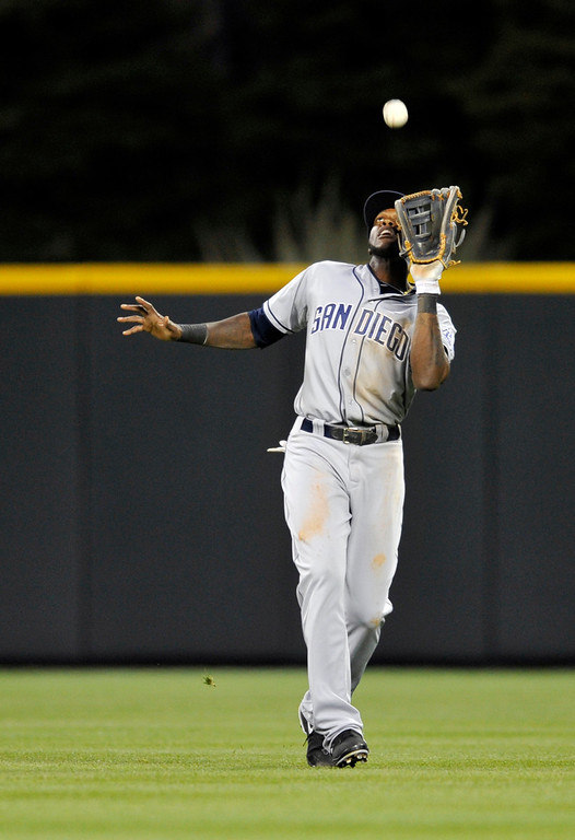 . San Diego Padres center fielder Cameron Maybin catches a fly ball against the Colorado Rockies during the fifth inning of a baseball game on Saturday, April 6, 2013, in Denver. (AP Photo/Jack Dempsey)
