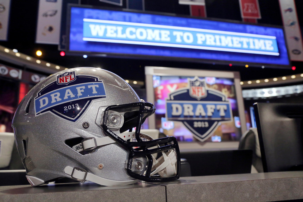 . A helmet with the NFL football draft logo is placed on a table before the first round, Thursday, April 25, 2013, at Radio City Music Hall in New York. (AP Photo/Mary Altaffer)