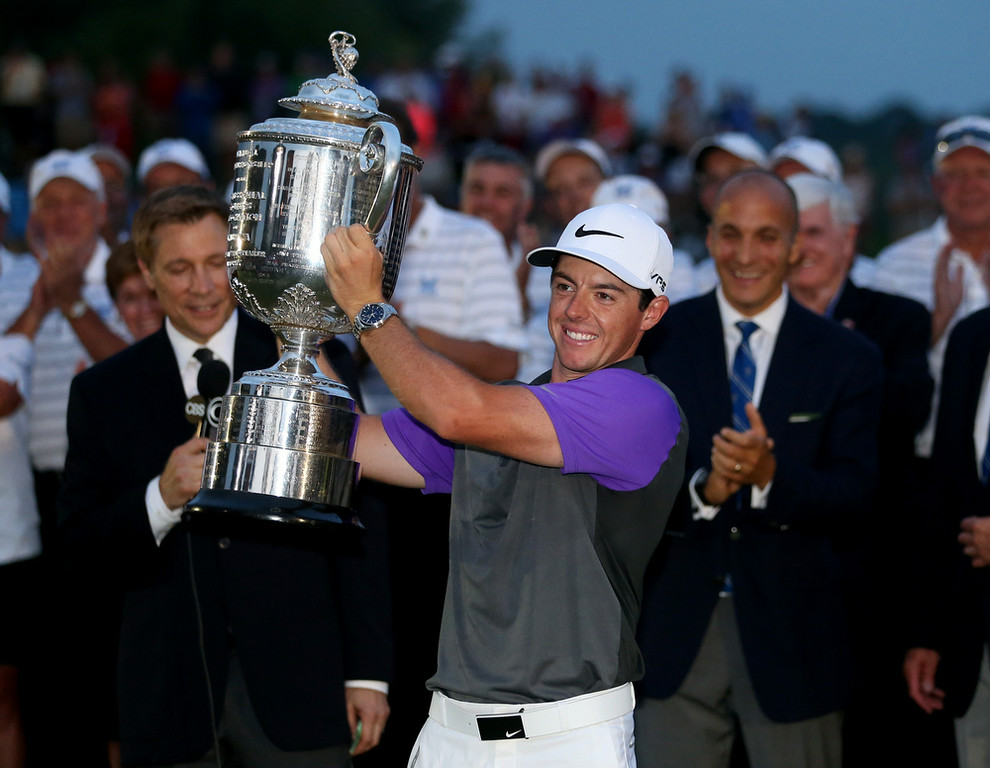 . Rory McIlroy of Northern Ireland celebrates with the Wanamaker trophy after his one-stroke victory during the final round of the 96th PGA Championship at Valhalla Golf Club on August 10, 2014 in Louisville, Kentucky.  (Photo by Andrew Redington/Getty Images)