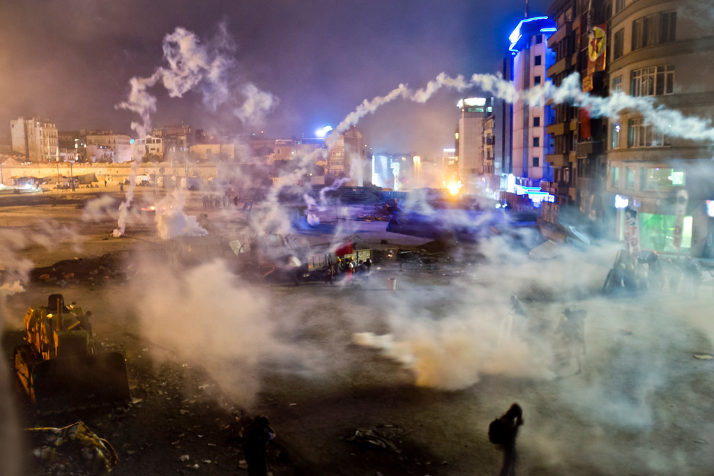 . Taksim Square is flooded by tear gas as clashes between protesters and riot police continue into the night in Istanbul Tuesday, June 11, 2013.  (AP Photo/Vadim Ghirda)