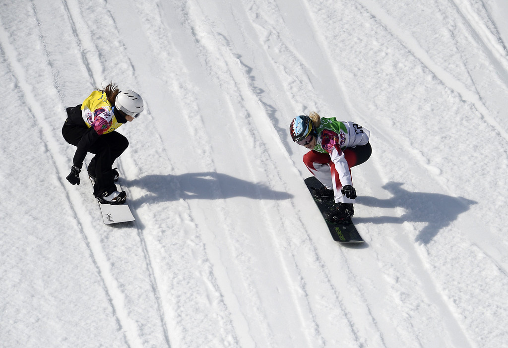 . Bulgaria\'s Alexandra Jekova (L) and Canada\'s Dominique Maltais compete in the Women\'s Snowboard Cross Semifinals at the Rosa Khutor Extreme Park during the Sochi Winter Olympics on February 16, 2014.     FRANCK FIFE/AFP/Getty Images