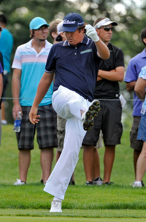 . Jason Dufner kicks at his club on the eighth fairway during the final round of the Bridgestone Invitational golf tournament Sunday, Aug. 4, 2013 at Firestone Country Club in Akron, Ohio. (AP Photo/Phil Long)