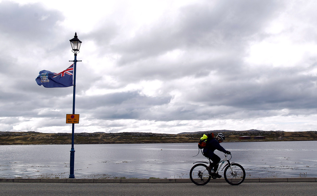 . A man rides his bicycle on Ross road in Stanley, March 11, 2013. Residents of the Falkland Islands started voting on Sunday and continue today in a sovereignty referendum that seeks to counter Argentina\'s increasingly assertive claim over the British-ruled territory.  REUTERS/Marcos Brindicci