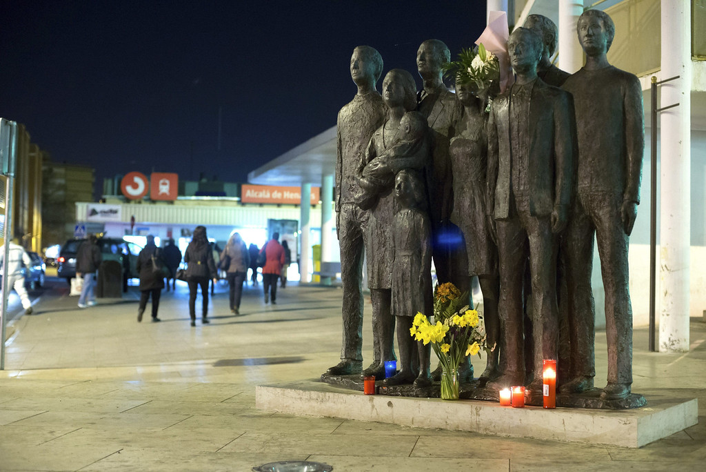 . A bouquet of flowers has been placed along with some candles at a memorial in Alcala de Henares train station in tribute to the victims who died in the madrid bombings ten years ago in Alcala de Henares, Madrid, Spain, 11 March 2014. A total of 191 people died and over 1,800 were injured after several islamist terrorists placed 11 explosive devices which blew up inside four commuter trains heading Atocha railway station downtown Madrid on 11 March 2004. EPA/FERNANDO VILLAR