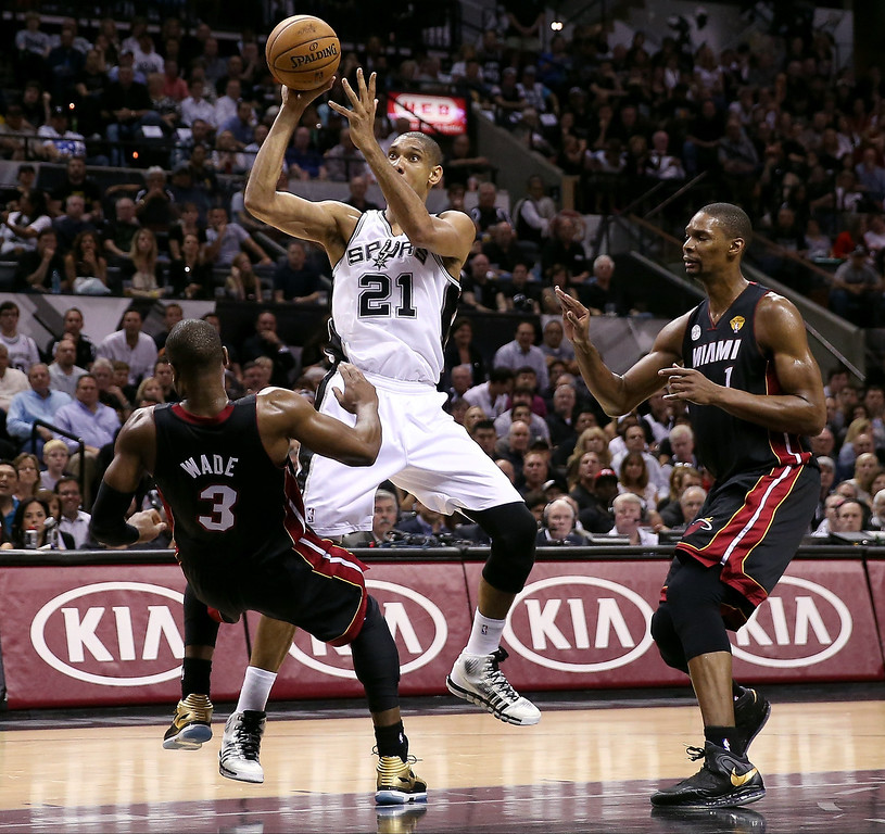 . Tim Duncan #21 of the San Antonio Spurs charges into Dwyane Wade #3 of the Miami Heat in the first half during Game Four of the 2013 NBA Finals at the AT&T Center on June 13, 2013 in San Antonio, Texas.  (Photo by Christian Petersen/Getty Images)