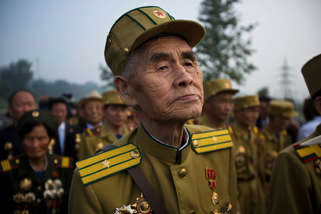 . North Korean veterans of the Korean War enter a cemetery for Korean War veterans on Thursday, July 25, 2013 in Pyongyang, North Korea during an opening ceremony marking the 60th anniversary of the signing of the armistice that ended hostilities on the Korean peninsula. (AP Photo/David Guttenfelder)