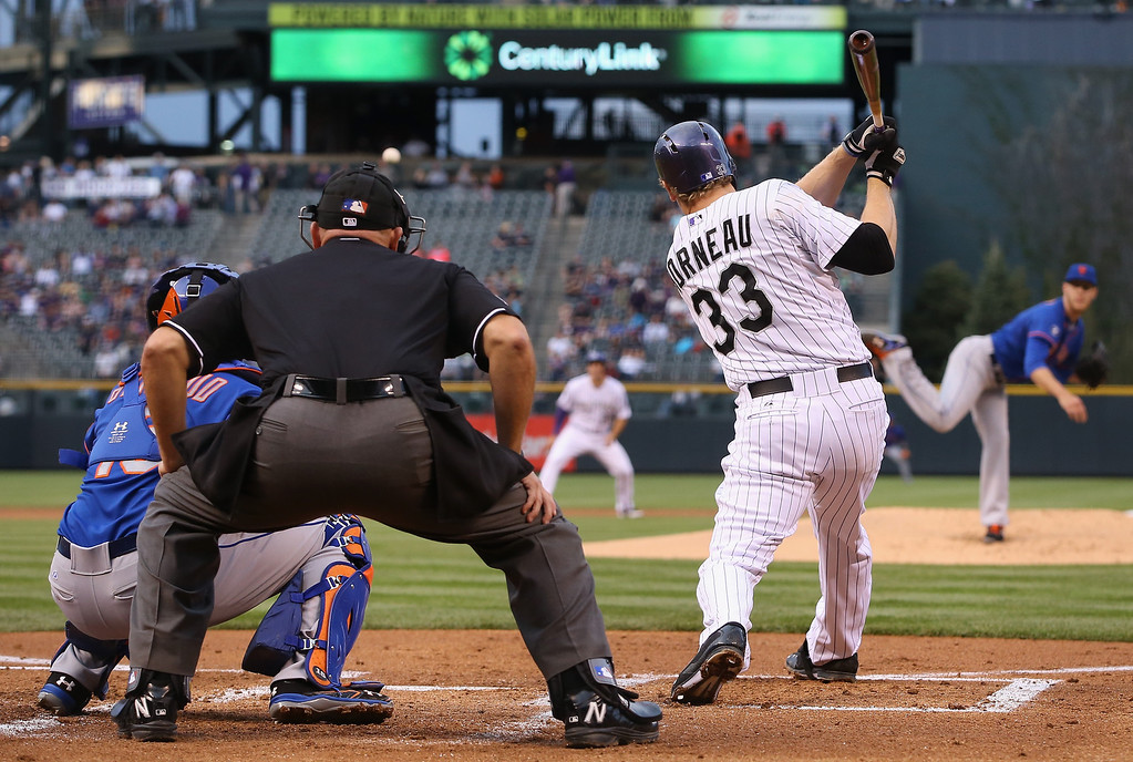. DENVER, CO - MAY 02:  Justin Morneau #33 of the Colorado Rockies hits an RBI double off of starting pitcher Zack Wheeler #45 of the New York Mets to score Nolan Arenado #28 of the Colorado Rockies and take a 2-1 lead in the first inning at Coors Field on May 2, 2014 in Denver, Colorado.  (Photo by Doug Pensinger/Getty Images)
