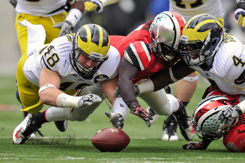 . Desmond Morgan #48 of the Michigan Wolverines and Corey Brown #3 of the Ohio State Buckeyes dive for a fumble at Ohio Stadium on November 24, 2012 in Columbus, Ohio. (Photo by Jamie Sabau/Getty Images)