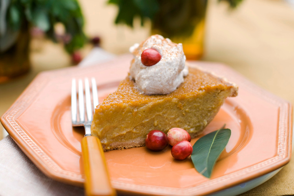 . In this image taken on Oct. 8, 2012, a slice of maple pumpkin pie with cinnamon-maple whipped cream is shown served on a plate in Concord, N.H. (AP Photo/Matthew Mead)
