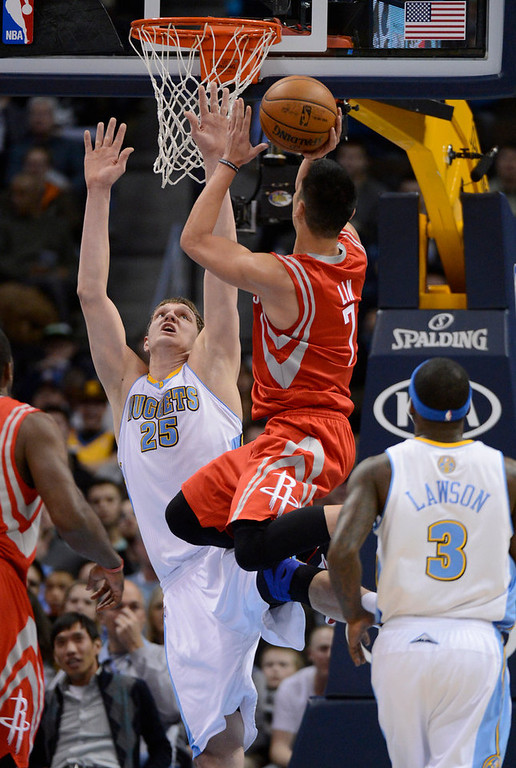 . DENVER, CO. - JANUARY 30: Houston Rockets point guard Jeremy Lin (7) gets fouled by Denver Nuggets center Timofey Mozgov (25) as he drives to the basket during the first quarter January 30, 2013 at Pepsi Center. The Denver Nuggets take on the Houston Rockets in NBA action. (Photo By John Leyba/The Denver Post)