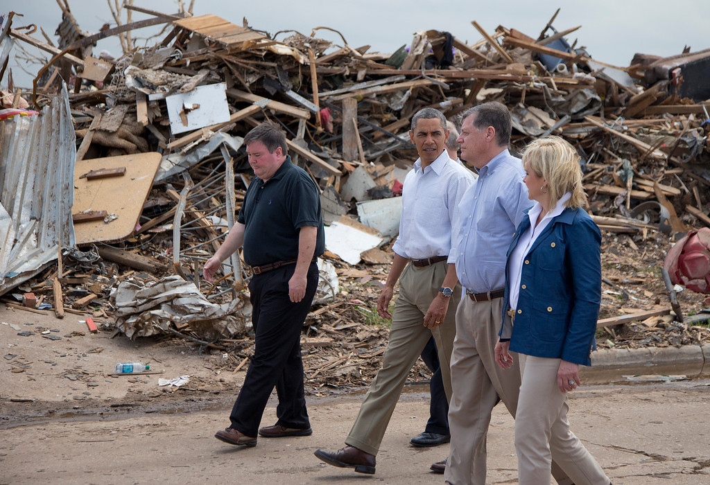 . President Barack Obama tours the devastated Plaza Towers Elementary School and surrounding area with Moore, Okla. Mayor Glenn Lewis, left, Oklahoma Gov. Mary Fallin, right, and Rep. Tom Cole, R-Okla., second from right,  Sunday, May 26, 2013, in Moore, Okla., caused by tornado and severe weather last week.  (AP Photo/Carolyn Kaster)
