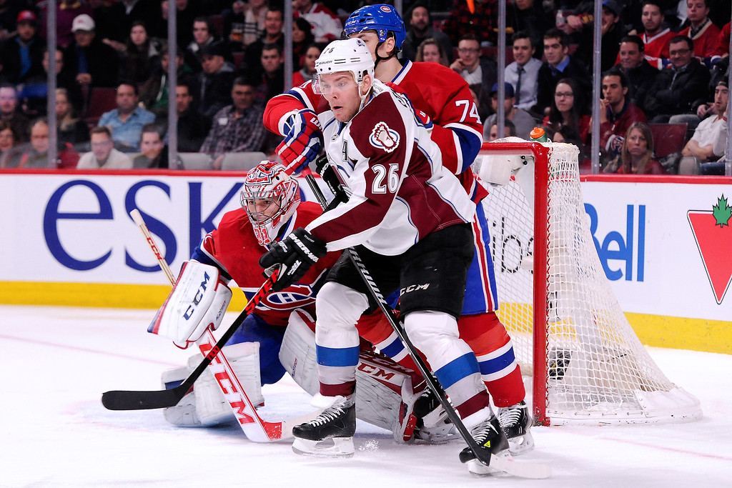 . MONTREAL, QC - MARCH 18:  Paul Stastny #26 of the Colorado Avalanche screens Carey Price #31 and Alexei Emelin #74 of the Montreal Canadiens during the NHL game at the Bell Centre on March 18, 2014 in Montreal, Quebec, Canada.  (Photo by Richard Wolowicz/Getty Images)