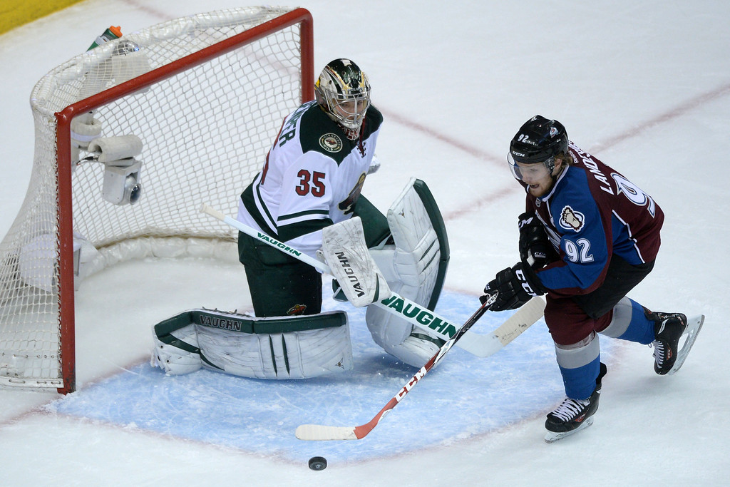 . DENVER, CO - APRIL 26: Gabriel Landeskog (92) of the Colorado Avalanche takes a shot on Darcy Kuemper (35) of the Minnesota Wild during the first period. The Colorado Avalanche hosted the Minnesota Wild during game five of the first round of the NHL Stanley Cup Playoffs at the Pepsi Center on Saturday, April 26, 2014. (Photo by Karl Gehring/The Denver Post)