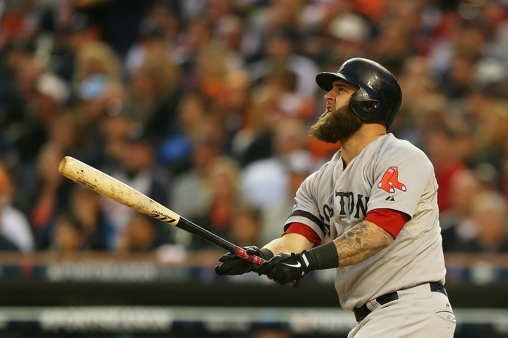 . Mike Napoli #12 of the Boston Red Sox hits a seventh inning homerun against the Detroit Tigers during Game Three of the American League Championship Series at Comerica Park on October 15, 2013 in Detroit, Michigan.  (Photo by Mike Ehrmann/Getty Images)