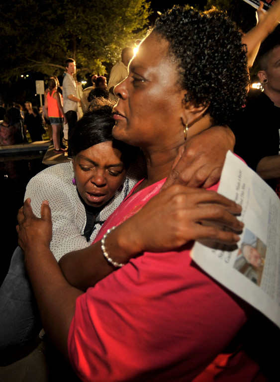 . Diane Whitaker (R) comforts Carmen Taylor as they react to the verdict outside Seminole County Court where George Zimmerman was found not guilty on second-degree murder and manslaughter charges in Sanford, Florida July 13, 2013. A Florida jury on Saturday found George Zimmerman not guilty in the shooting death of unarmed black teenager Trayvon Martin, in a case that sparked a national debate on race and guns. REUTERS/Steve Nesius