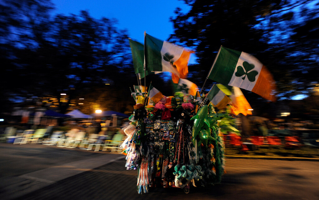 . A street vendor rolls his cart along the parade route at dawn before Savannahís 189-year-old St. Patrickís Day parade, Saturday, March 16, 2013, in Savannah, Ga. (AP Photo/Stephen Morton)