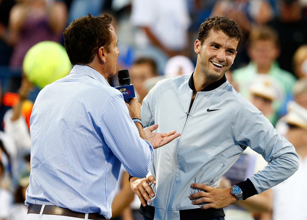 . NEW YORK, NY - AUGUST 27:  Grigor Dimitrov of Bulgaria is interview after defeating Ryan Harrison of the United States during their men\'s singles first round match on Day Three of the 2014 US Open at the USTA Billie Jean King National Tennis Center on August 27, 2014  in the Flushing neighborhood of the Queens borough of New York City.  (Photo by Julian Finney/Getty Images)