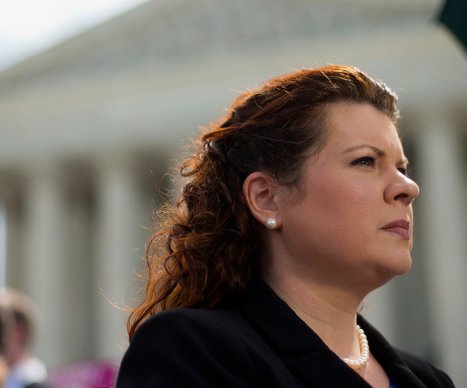 . Lori Windham, the attorney representing Hobby Lobby, stands outside the Supreme Court in Washington, Monday, June 30, 2014, following the decision on the Hobby Lobby case. (AP Photo/Pablo Martinez Monsivais)