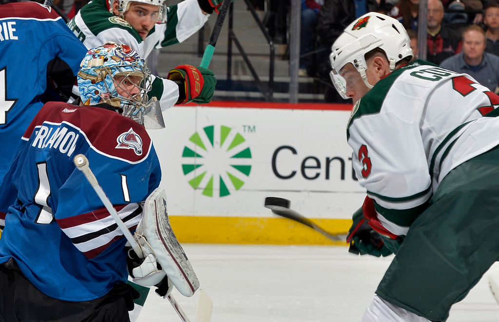. Colorado Avalanche goalie Semyon Varlamov (1), from Russia, blocks a shot by Minnesota Wild center Charlie Coyle (3) during the second period of an NHL hockey game on Saturday, Nov. 30, 2013, in Denver. (AP Photo/Jack Dempsey)