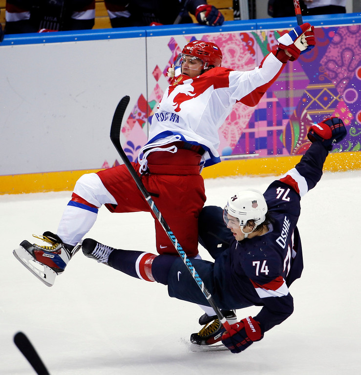 . Russia forward Alexander Ovechkin is upended by USA forward T.J. Oshie in the third period of a men\'s ice hockey game at the 2014 Winter Olympics, Saturday, Feb. 15, 2014, in Sochi, Russia. (AP Photo/Petr David Josek)