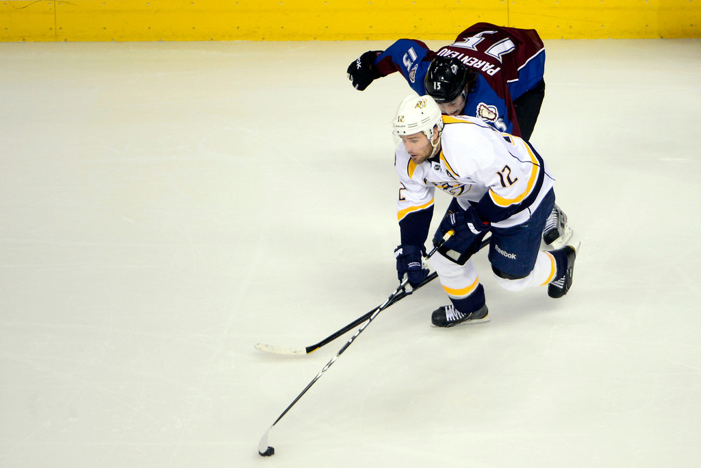. Chuck Kobasew (12) of the Colorado Avalanche defends Mike Fisher (12) of the Nashville Predators during the second period of action. The Colorado Avalanche take on the Nashville Predators at the Pepsi Center on February 18, 2013. (Photo By AAron Ontiveroz/The Denver Post)