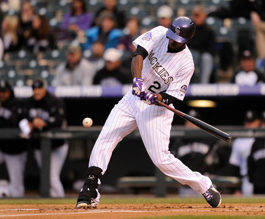 . DENVER, CO. - APRIL 19:  Dexter Fowler connected with a pitch in the first inning off Arizona starter Ian Kennedy. The Colorado rockies hosted the Arizona Diamondbacks at Coors Field Friday night, April 19, 2013.  Photo By Karl Gehring/The Denver Post)