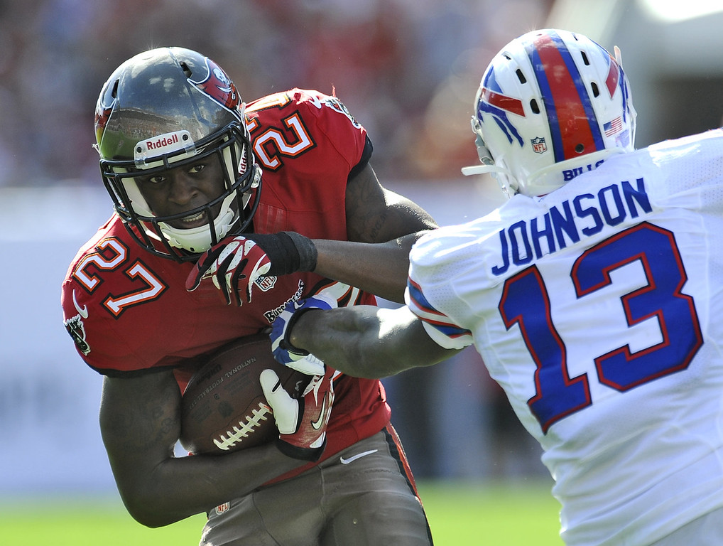 . Tampa Bay Buccaneers cornerback Johnthan Banks (27) is stopped by Buffalo Bills wide receiver Steve Johnson (13) after intercepting a pass during the second quarter of an NFL football game on Sunday, Dec. 8, 2013, in Tampa, Fla. (AP Photo/Brian Blanco)