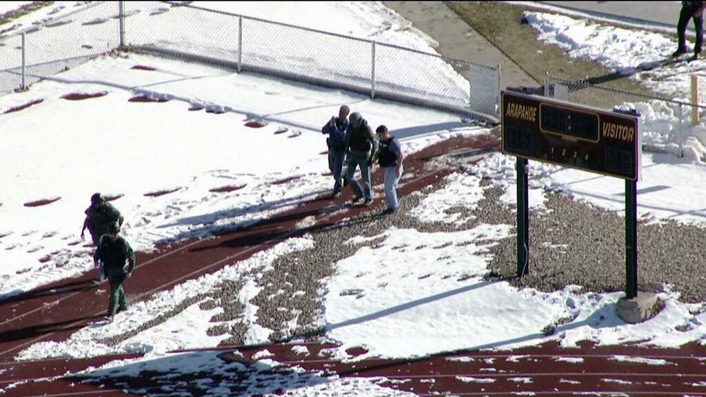 . In this still image taken from video provided by Fox 31 Denver, police respond to reports of a shooting at Arapahoe High School in Centennial, Colo. Friday, Dec. 13, 2013. Colorado division of emergency management spokeswoman Micki Trost said her director went to the school and their weren\'t any more immediate details. (AP Photo/KDVR)