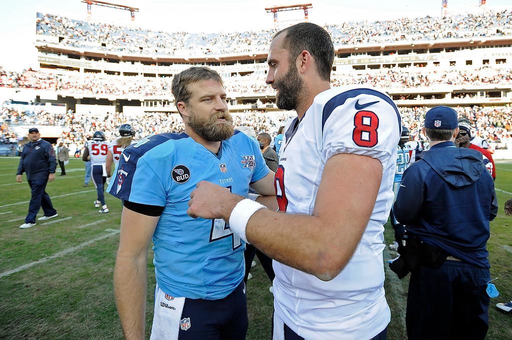 . Tennessee Titans quarterback Ryan Fitzpatrick (4) talks with Houston Texans quarterback Matt Schaub (8) after the Titans beat the Texans 16-10 in an NFL football game Sunday, Dec. 29, 2013, in Nashville, Tenn. (AP Photo/Mark Zaleski)