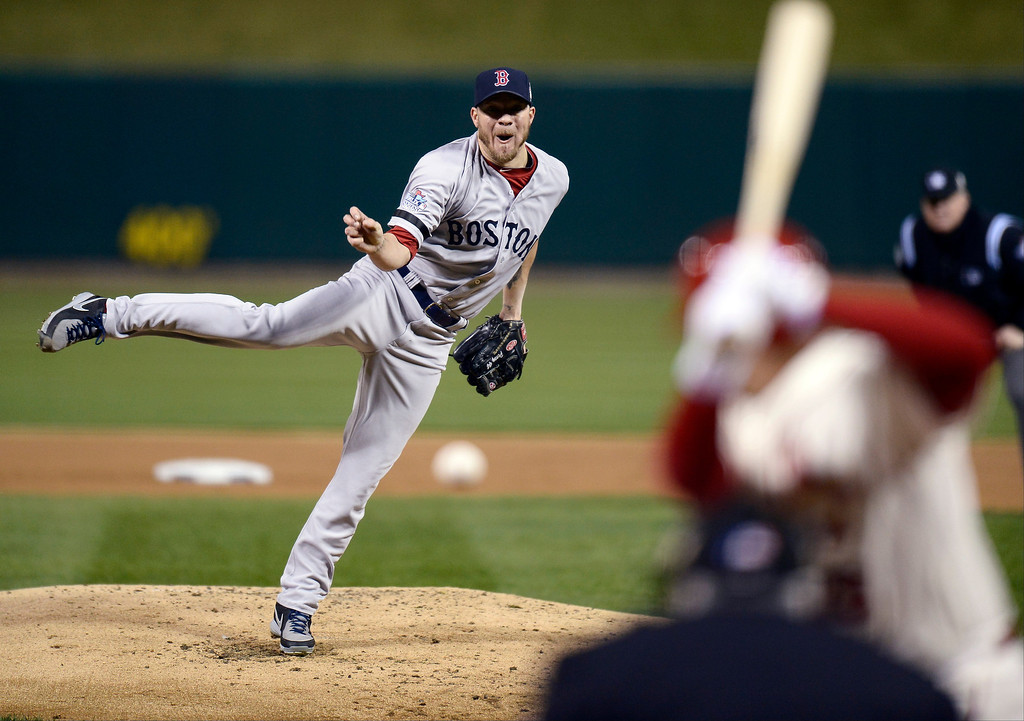 . Boston Red Sox starting pitcher Jake Peavy throws during the first inning of Game 3 of Game 3 of baseball\'s World Series against the St. Louis Cardinals Saturday, Oct. 26, 2013, in St. Louis. (AP Photo/Tannen Maury, Pool)