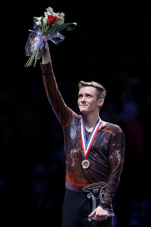 . Jeremy Abbott celebrates on the medals podium after winning the men\'s competition during the Prudential U.S. Figure Skating Championships at TD Garden on January 12, 2014 in Boston, Massachusetts.  (Photo by Matthew Stockman/Getty Images)