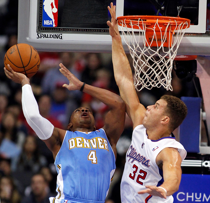 . Denver Nuggets guard Randy Foye (4) shoots with Los Angeles Clippers forward Blake Griffin (32) defending during the first half of an NBA basketball game in Los Angeles on Saturday, Dec. 21, 2013. (AP Photo/Alex Gallardo)