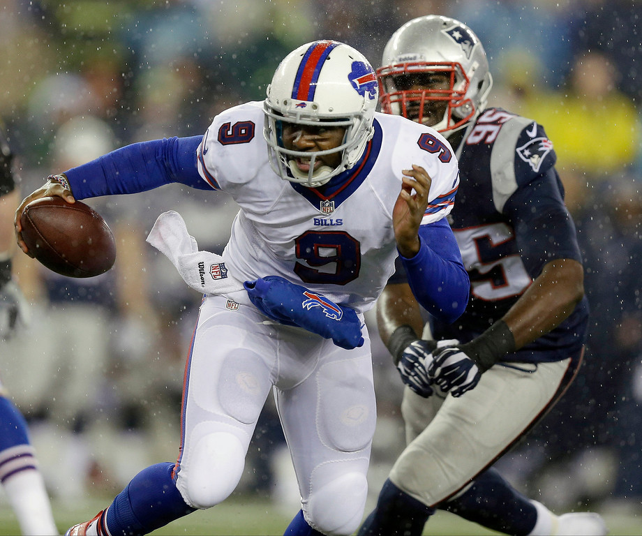 . Buffalo Bills quarterback Thad Lewis (9) scrambles away from New England Patriots defensive end Chandler Jones (95) in the first quarter of an NFL football game, Sunday, Dec. 29, 2013, in Foxborough, Mass. (AP Photo/Steven Senne)