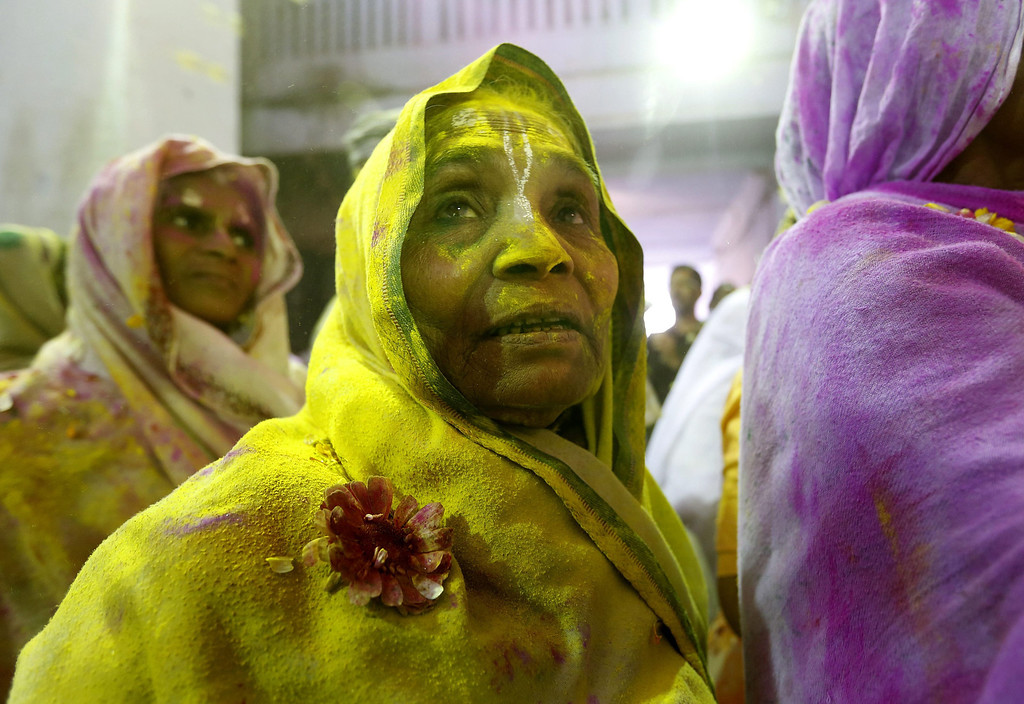 . Indian widows are covered with colors while participating in the Holi festival in Vrindavan, Uttar Pradesh, India, March 14, 2014.  EPA/HARISH TYAGI
