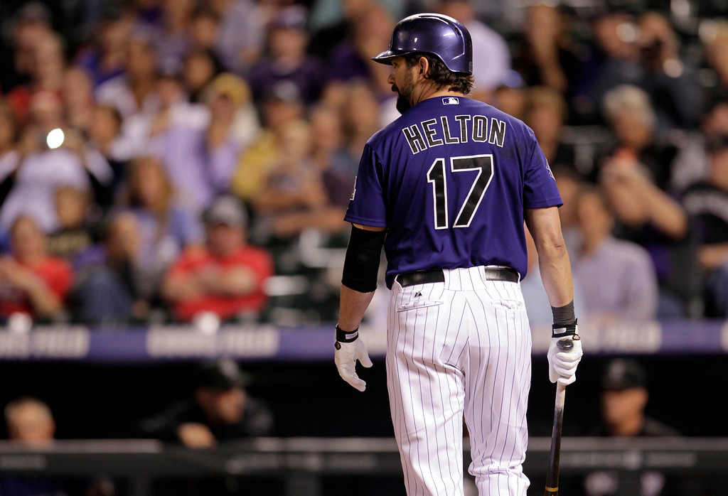 . Colorado Rockies\' Todd Helton walks back to the dugout after his pop out to St. Louis Cardinals catcher Yadier Molina in the seventh inning of a baseball game in Denver on Monday, Setp. 16, 2013.(AP Photo/Joe Mahoney)