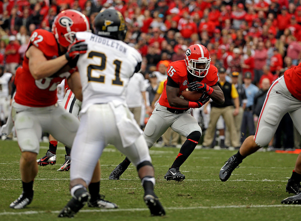 . Georgia running back J.J. Green, right, runs the ball in for a touchdown in the third quarter of an NCAA college football game against Appalachian State, Saturday, Nov. 9, 2013, in Athens, Ga. (AP Photo/David Goldman)