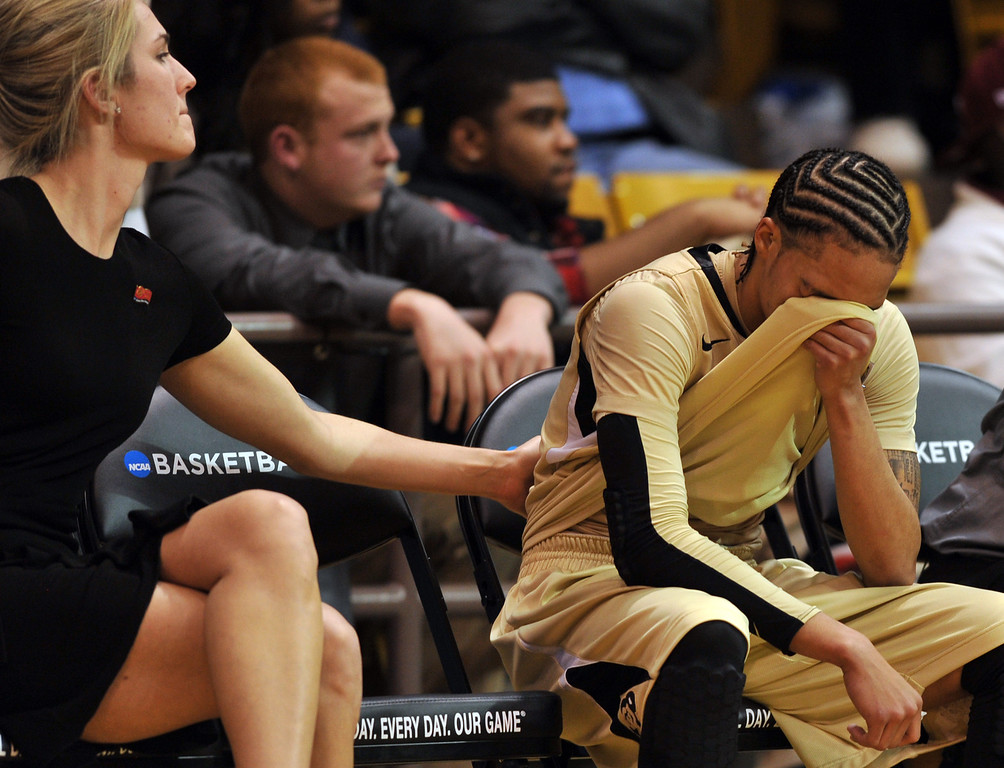 . BOULDER, CO. - MARCH 23: Assistant coach Kelly Rae Finley, left, comforts Chucky Jeffery of Colorado Buffaloes (23), right, in the end of the first round of the 2013 NCAA women\'s Basketball Tournament against Kansas Jayhawks at Coors Events Center. Boulder, Colorado. March 23, 2013. Kansas won 67-52. (Photo By Hyoung Chang/The Denver Post)